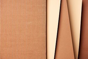 Paper sheets in beige and brown tone
