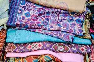 Indian fabrics folded on the counter