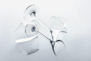 broken wineglass on white reflecting