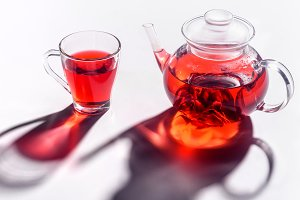 glass teapot and glass cup with hibi