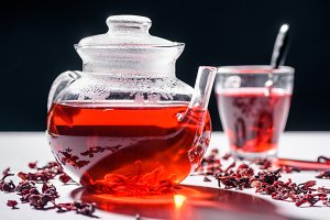 glass teapot with hibiscus tea and c