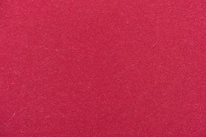 texture of maroon color paper as bac