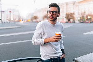 Hipster man standing with takeaway c