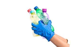 Hands holding plastic bottle