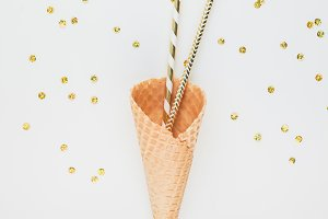 Golden party straws in waffle cone