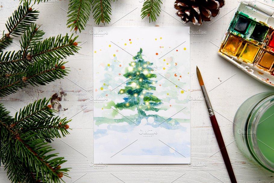 Painting a watercolor Christmas card ~ Photos ~ Creative Market