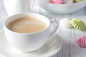 Cup of coffee with colored meringues