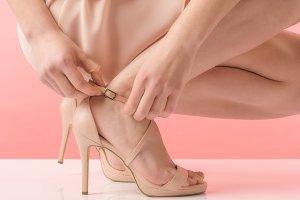 partial view of girl in pink heels,
