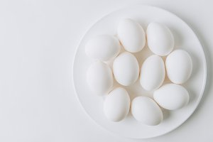 white eggs laying on white plate on