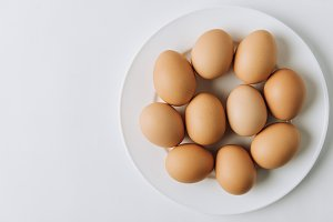 brown eggs laying on white plate on