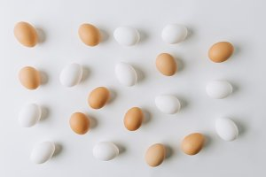 white and brown eggs scattered on wh