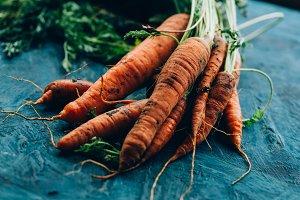 Fresh carrots on a blue wooden backg