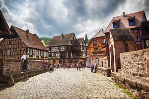 tourists on bridge, Alsace village