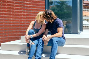 Couple kissing in front new house