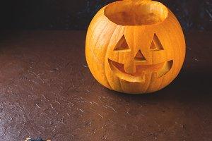Halloween carved squash on dark