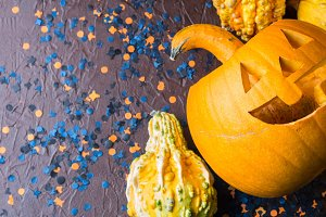 Halloween carved squash and confetti