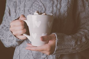 Hands holding cup of hot chocolate