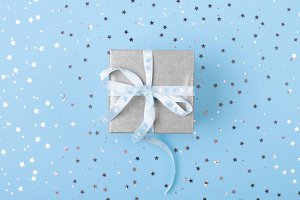 Christmas gift with blue ribbon