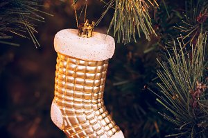 Golden sock on the Christmas tree