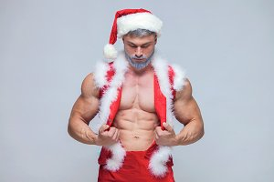 Christmas. Sexy Santa Claus . Young