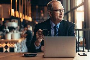 Senior businessman sitting at coffee