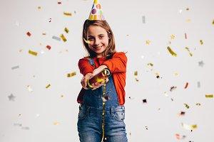 Girl bursting a party popper