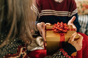 Elderly couple exchanging gifts