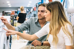 Young woman and man shopping applian