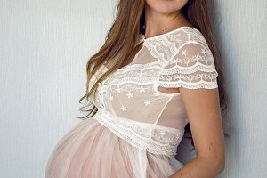pregnant girl in a white transparent