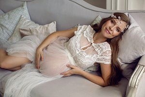 pregnant girl in white see-through