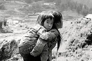 Girl carrying little sister, Vietnam