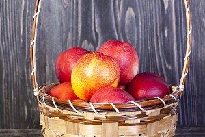 basket of ripe peaches