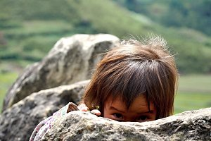 Girl hiding behind the rock, Vietnam