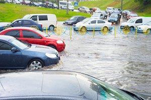 car traffic on flooded street