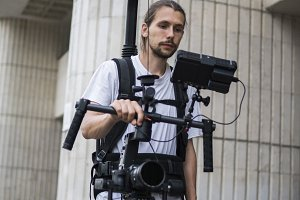 Professional videographer holding