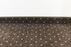Brown carpet floor with a white dots
