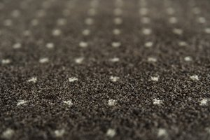 Brown carpet with a white dots