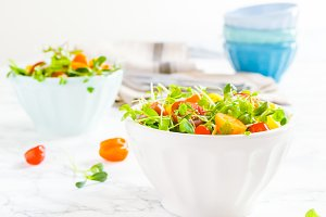 Mixed baby greens and tomatoes salad