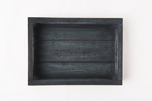 Empty dark wooden box isolated on wh