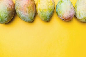 Fresh mango on yellow