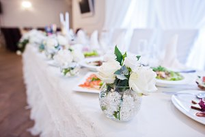 Flowers decor on table of newlyweds