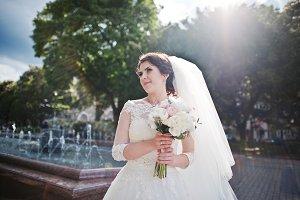 Portrait of brunette bride with bouq