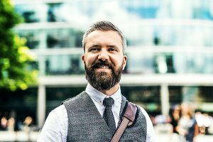 Hipster businessman standing on the