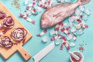 Raw pink dorado fish cooking