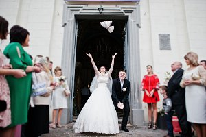 Happy wedding couple puts in the air