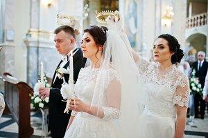 Bridesmaid holding wedding crown at