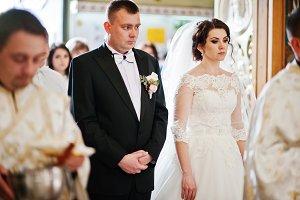 Wedding couple indoor at church ente