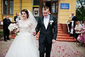 Happy wedding couple walking at path