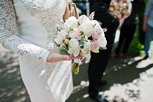 Close up wedding bouquet at hand of