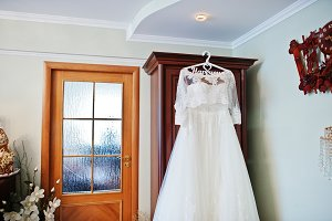 White wedding dress of bride on hang